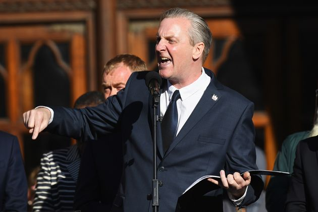 Poet Tony Walsh speaks as members of the public gather at a vigil to honour the victims of Monday evening's...