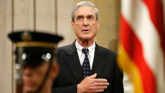 Outgoing FBI Director Robert Mueller stands for the national anthem during a farewell ceremony for him at the Justice Department in Washington, August 1, 2013. On Monday the U.S. Senate confirmed former Deputy Attorney General James Comey to replace Mueller, who has led the bureau since shortly before the September 11, 2001, attacks on the United States.  REUTERS/Jonathan Ernst    (UNITED STATES - Tags: POLITICS CRIME LAW)