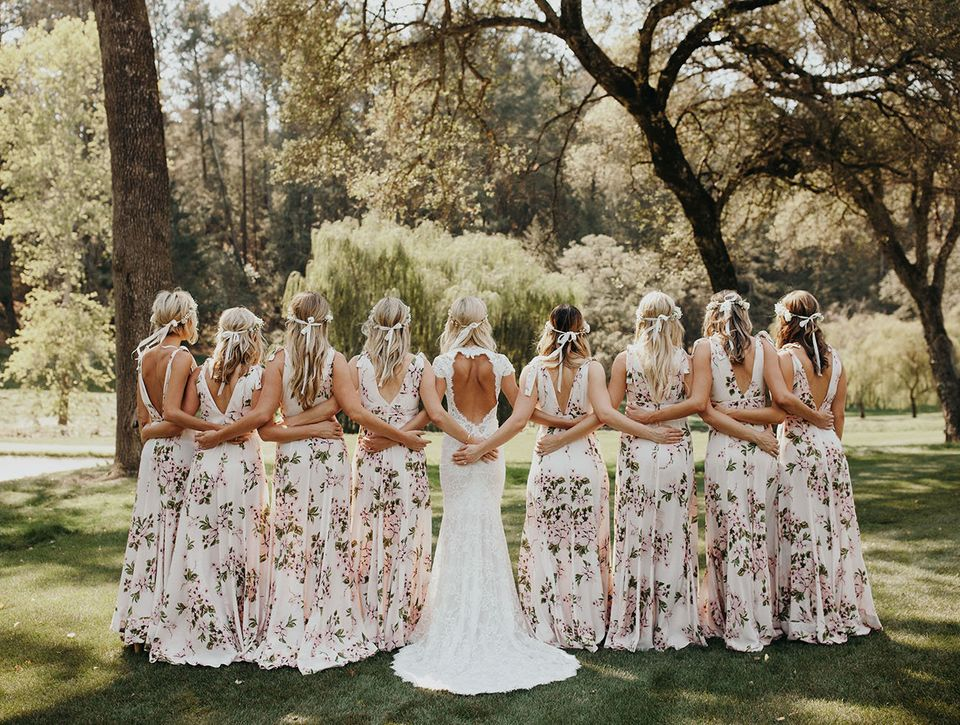 615c22a2068c0 Floral Bridesmaid Dresses Are The Wedding Trend That Will Grow On ...