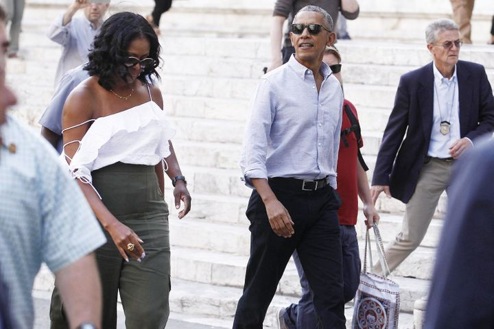 Former U.S. President Barack Obama and Michelle Obama take a walk during their visit to Siena, Tuscany, Italy, on May 22.