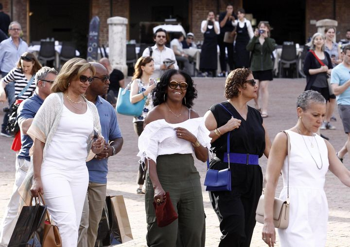Former U.S. first lady Michelle Obama takes a walk through Piazza del Campo's Square during her and husband's visit to Siena, Tuscany, Italy on May 22.