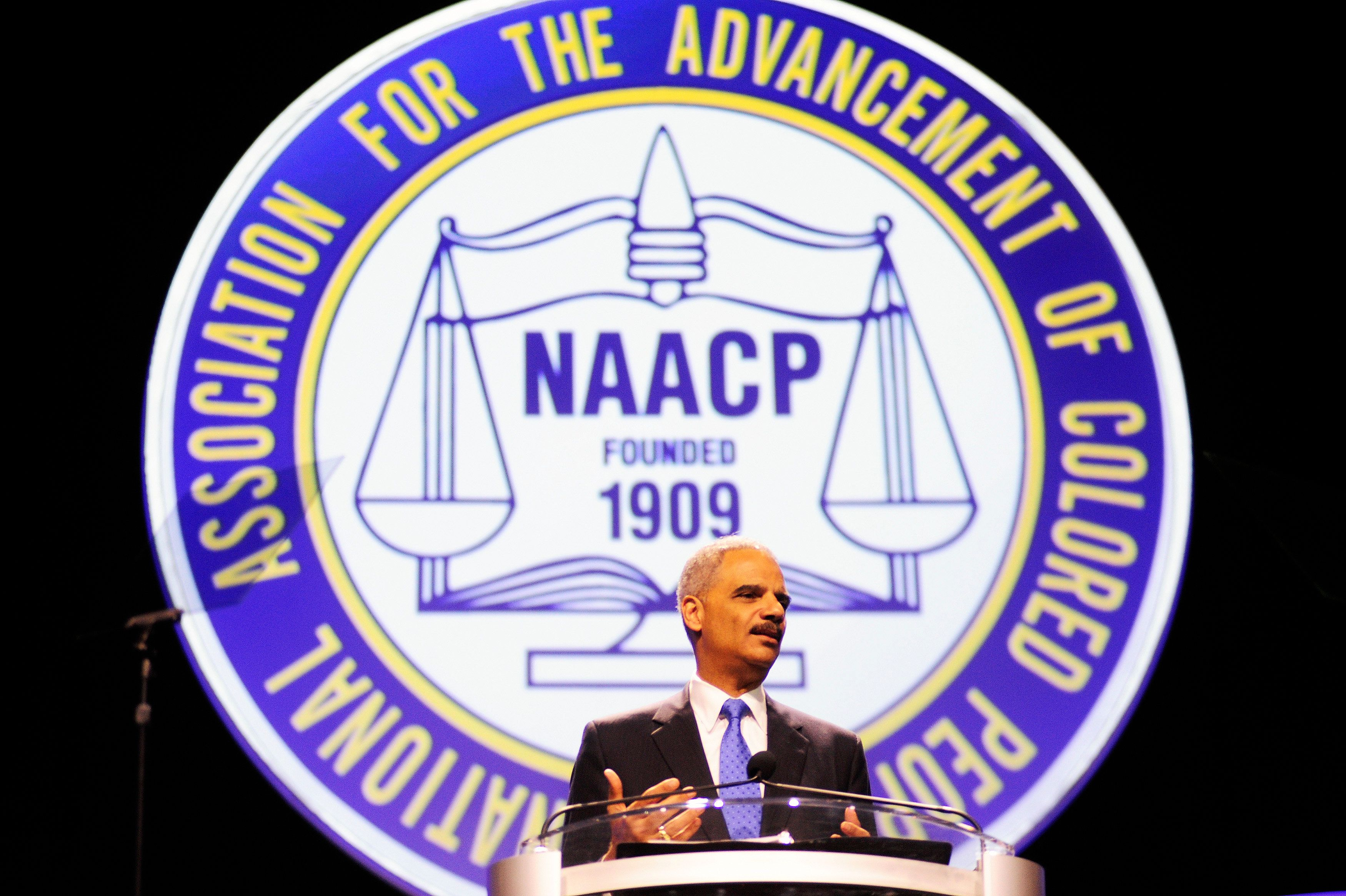 """U.S. Attorney General Eric Holder speaks at the annual convention of the National Association for the Advancement of Colored People (NAACP) in Orlando July 16, 2013. Holder told the major civil rights convention that controversial """"Stand Your Ground"""" self-defense laws that have been adopted in 30 states should be reconsidered.  REUTERS/David Manning  (UNITED STATES - Tags: POLITICS CRIME LAW)"""