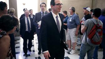 WASHINGTON, DC - MAY 17:  Treasury Secretary Steve Mnuchin (C) arrives at the offices of Speaker of the House Paul Ryan (R-WI) at the U.S. Capitol May 17, 2017 in Washington, DC. Mnuchin met with Ryan and other Congressional Republicans to talk about President Donald Trump's tax reform plan.  (Photo by Chip Somodevilla/Getty Images)