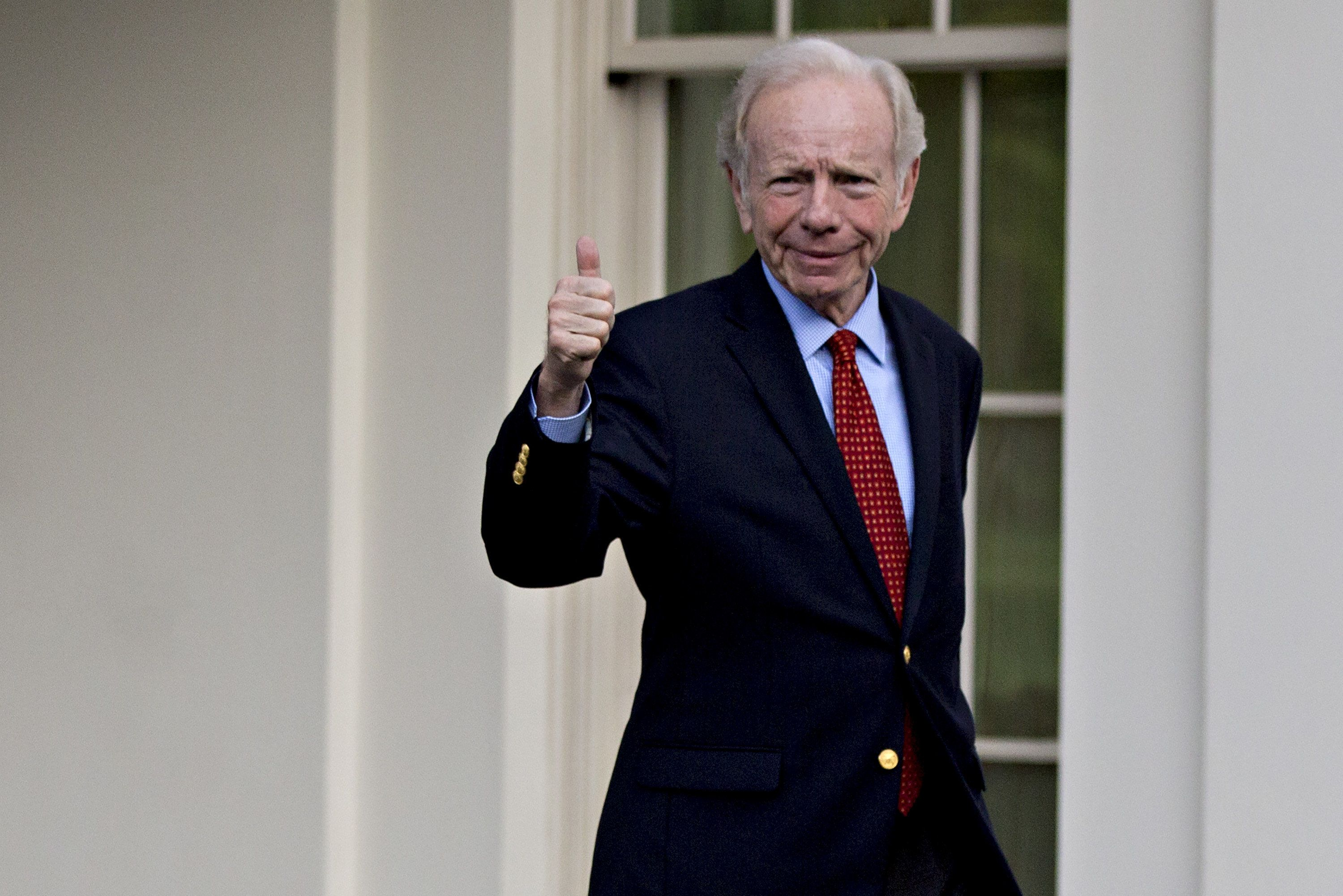 Former Senator Joe Lieberman, an Independent from Connecticut, gives a thumbs-up while walking out of the West Wing of the White House after a meeting with U.S. President Donald Trump, not pictured, in Washington, D.C., U.S., on Wednesday, May 17, 2017. White House press secretary Sean Spicer announced today that Trump would be meeting with four candidates for the position of director of the Federal Bureau of Investigation (FBI) including Lieberman. Photographer: Andrew Harrer/Bloomberg via Getty Images