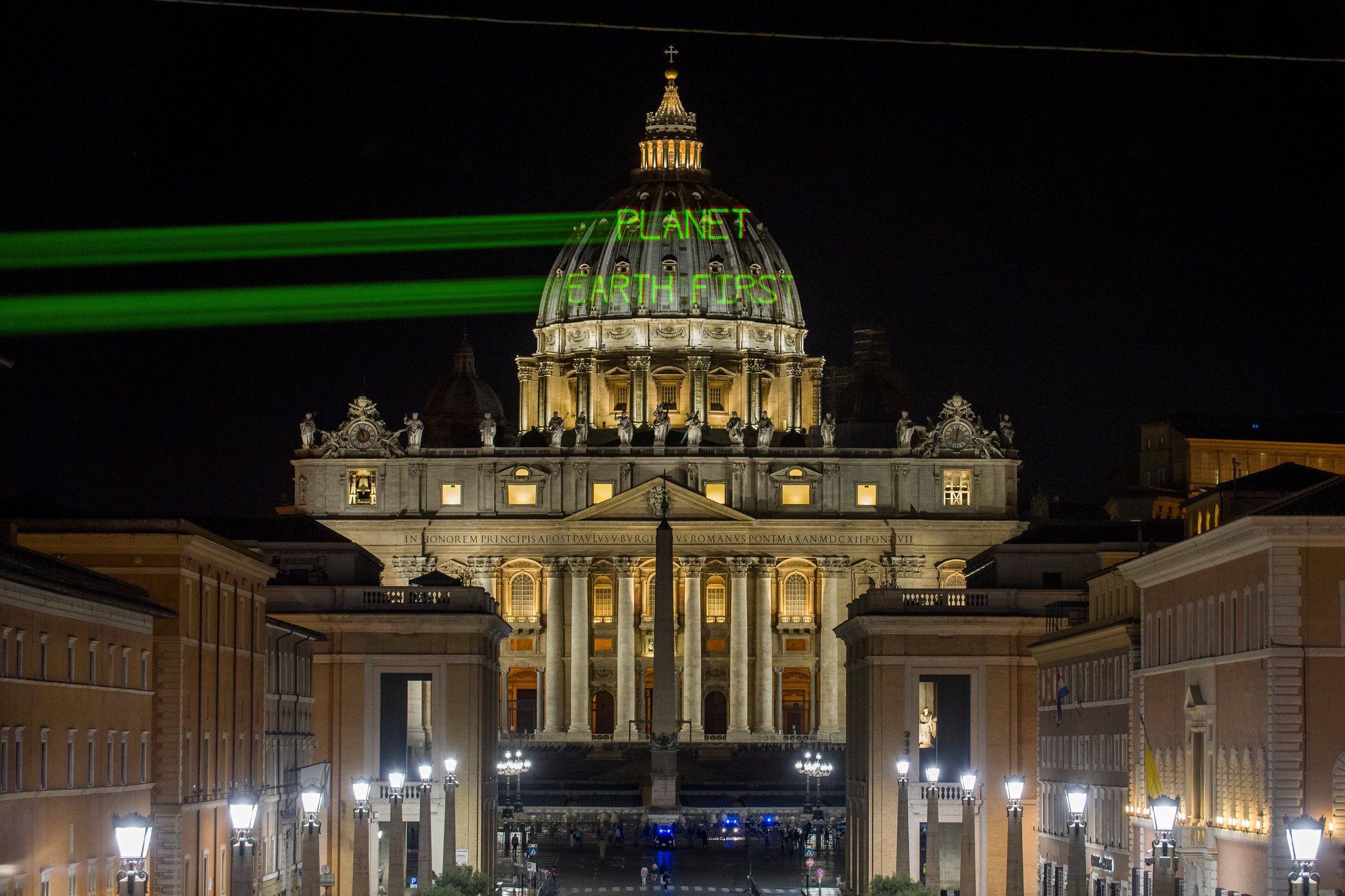 A few hours before the meeting between Pope Francis and President Donald Trump, Greenpeace activists...