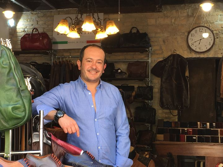 "Federico Placidis' family has owned leather goods stores in Rome for 50 years. He describes Trump as a ""strong man."""