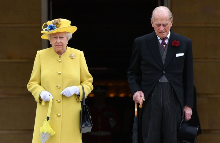 The Queen and Prince Philip both observed a minute's silence at the start of a garden party at Buckingham Palace on Tuesday