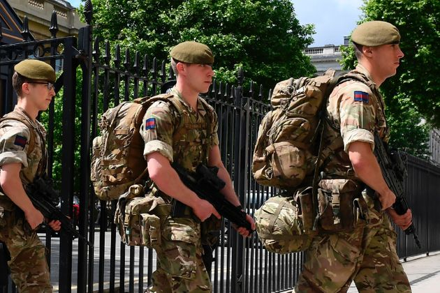 British soldiers enter a Ministry of Defence building near to New Scotland Yard police headquarters near...