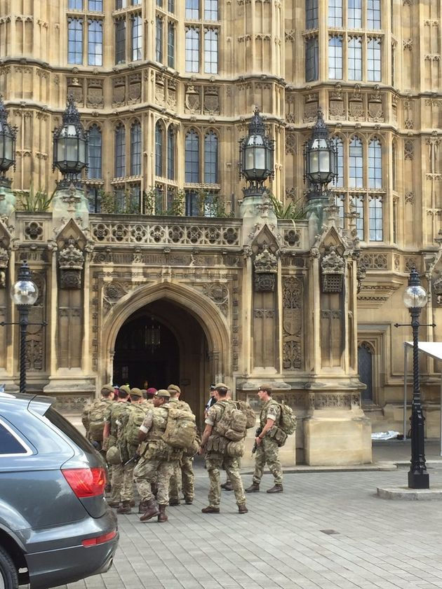 Armed soldiers were pictured arriving at Parliament on Wednesday amid a
