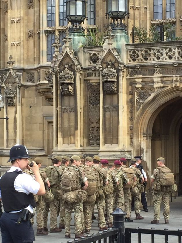 The unusual sight of military service people arriving at Parliament comes amid increased