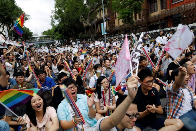 Supporters react during a rally after Taiwan's constitutional court ruled that same-sex couples have...