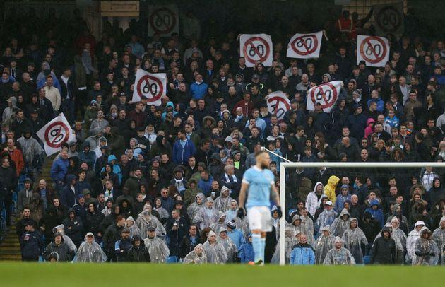 Fans protest against ticket prices at the Etihad stadium,