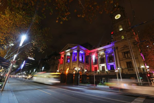 The colors of the Union Jack, the national flag of the United Kingdom, are projected onto Melbourne's town hall as a tribute