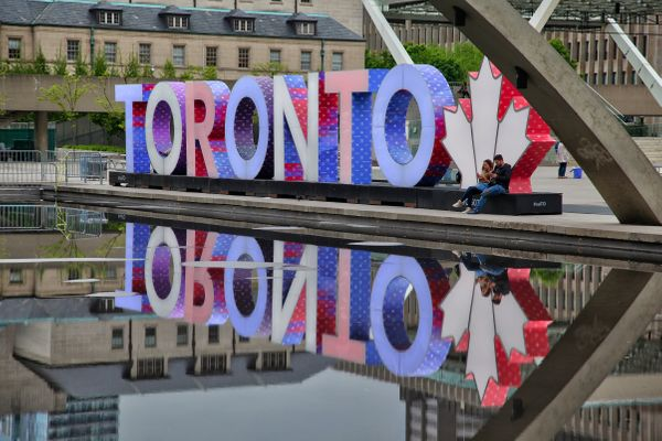 Sign in Toronto illuminated with the colors of the United Kingdom flag as a tribute to victims of the terror attack in Manche