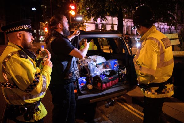 Des Richardson, owner of Canine Motorcycle Recovery, hands out free food and drinks to police and the public following an eve