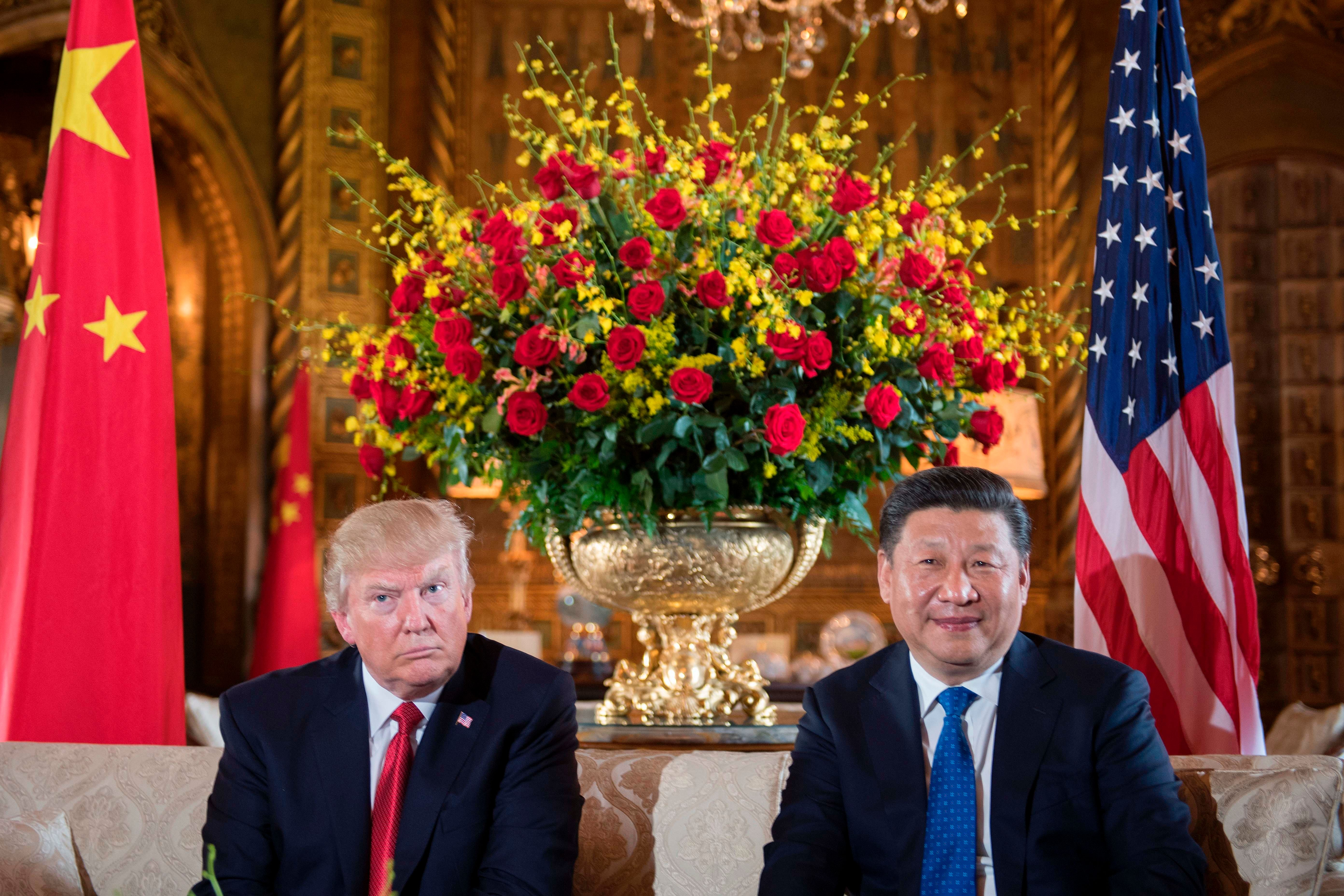 US President Donald Trump (L) sits with Chinese President Xi Jinping (R) during a bilateral meeting at the Mar-a-Lago estate in West Palm Beach, Florida, on April 6, 2017. / AFP PHOTO / JIM WATSON        (Photo credit should read JIM WATSON/AFP/Getty Images)