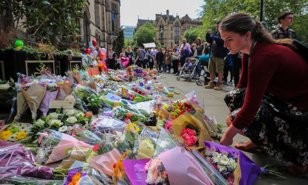 People lay flowers outside the town hall in Albert Square, Manchester.