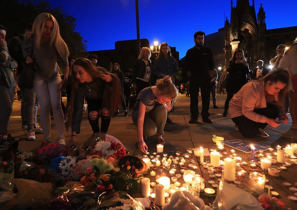 People leave tributes to victims of the Manchester attack in Albert Square, Manchester.