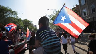 CHICAGO, IL - MAY 18: Supporters march with Puerto Rican nationalist Oscar López Rivera to a rally organized in Lopez's honor in the Humboldt Park neighborhood on May 18, 2017 in Chicago, Illinois. López, who once lived in Chicago was released from federal custody yesterday, his prison sentence being commuted by President Barack Obama before he left office. Lopez was one of the leaders of the Armed Forces of National Liberation (FALN), a Puerto Rican group that claimed responsibility for more than 100 bombings at government buildings, department stores, banks and restaurants in New York, Chicago, Washington D.C. and Puerto Rico during the 1970s and early 1980s.  (Photo by Scott Olson/Getty Images)
