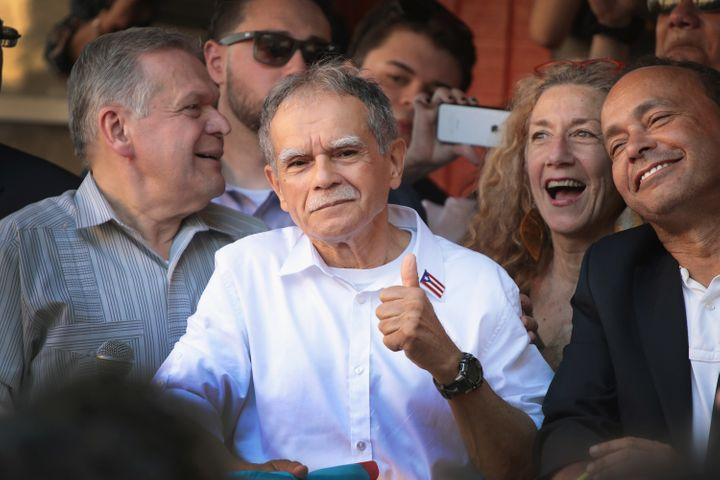U.S. Rep. Luis Gutierrez (D-Ill.), right, and Puerto Rican nationalist Oscar López Rivera, center, attend a rally