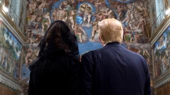 VATICAN CITY, VATICAN - MAY 24: (----EDITORIAL USE ONLY  MANDATORY CREDIT - ' L'OSSERVATORE ROMANO / HOLY SEE PRESS OFFICE / HANDOUT' - NO MARKETING NO ADVERTISING CAMPAIGNS - DISTRIBUTED AS A SERVICE TO CLIENTS----) U.S. President Donald Trump (R) and his wife Melania Trump (L) are seen as they visit the Sistine Chapel in Vatican City on May 24, 2017. (Photo by L'Osservatore Romano / Handout/Anadolu Agency/Getty Images)