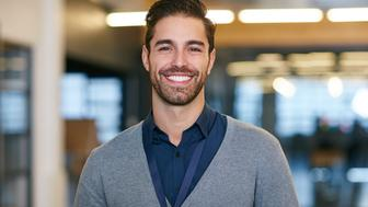 Cropped portrait of a young man standing in the office