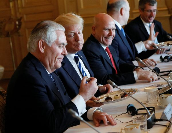 U.S. Secretary of State Rex Tillerson, Trump and national security adviser H.R. McMaster eat Belgian chocolate during their m