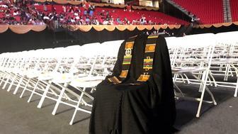 Richard Collins IIIs empty chair at graduation