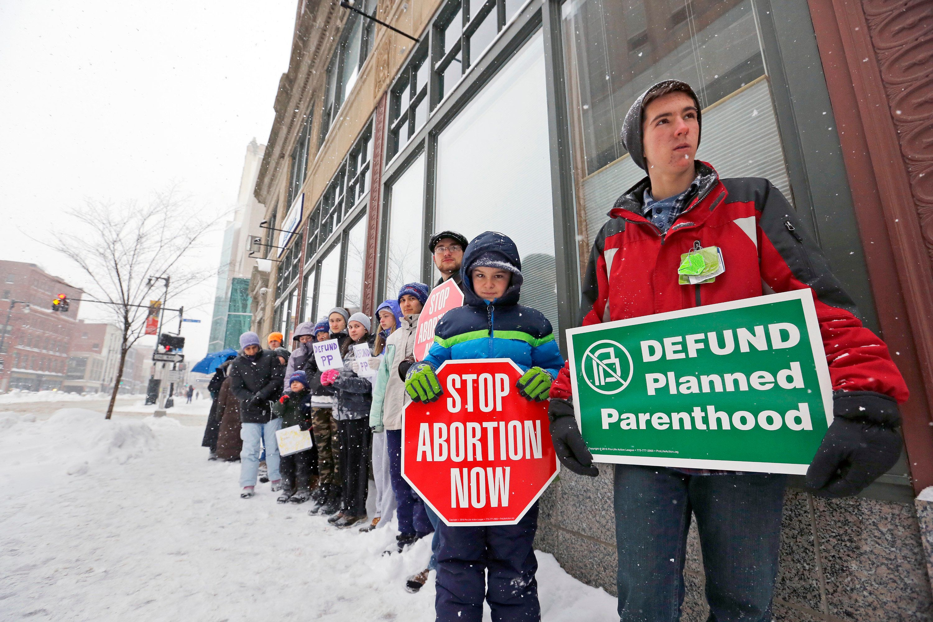 Anti-abortion protestors stand outside a Planned Parenthood clinic in Portland, Maine in February.