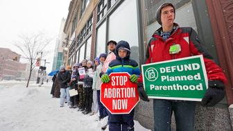 PORTLAND, ME - FEBRUARY 11: About 30 anti-abortion protesters gathered outside Planned Parenthood's Congress Street location on Saturday to call for federal defunding of the low-cost reproductive health organization. (Staff photo by Ben McCanna/Portland Press Herald via Getty Images)