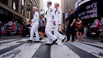 U.S. Navy sailors walk through Times Square during Fleet Week in New York, U.S., May 25, 2016. REUTERS/Lucas Jackson