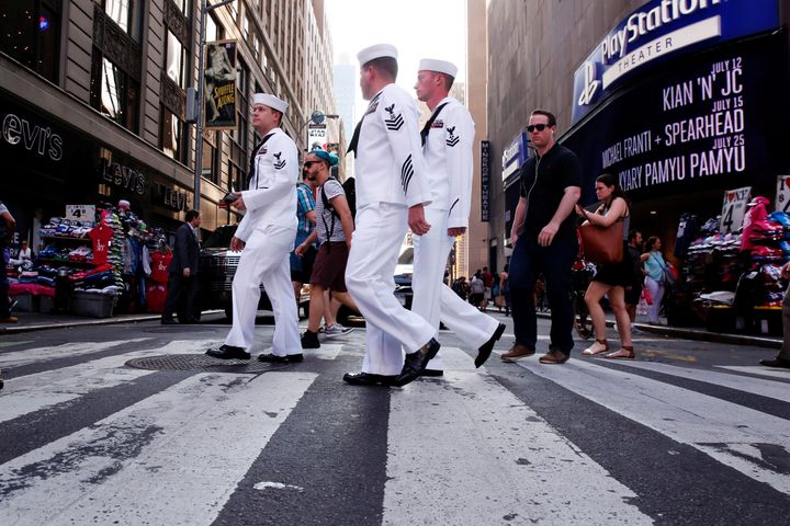 U.S. Navy sailors walk through Times Square during Fleet Week in New York City.