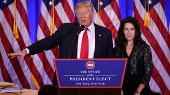 US President-elect Donald Trump gives a press conference with his Attorney Sheri Dillon (R) January 11, 2017 in New York. Donald Trump is holding his first news conference in nearly six months Wednesday, amid explosive allegations over his ties to Russia, a little more than a week before his inauguration. / AFP / DON EMMERT        (Photo credit should read DON EMMERT/AFP/Getty Images)