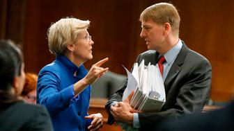 U.S. Senator Elizabeth Warren (D-MA) (L) talks with U.S. Consumer Financial Protection Bureau Director Richard Cordray (R) after he testified about Wall Street reform before a Senate Banking Committee hearing on Capitol Hill in Washington September 9, 2014. REUTERS/Jonathan Ernst    (UNITED STATES - Tags: POLITICS BUSINESS)