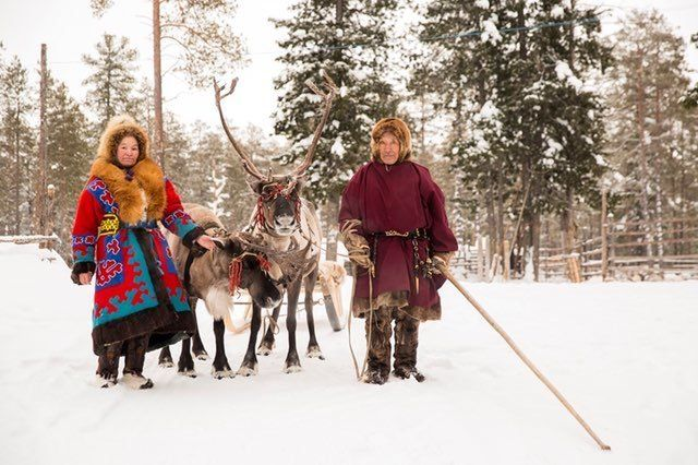 Reindeer herders are seen near Numto Lake in western Siberia. Russia's recent decision to redraw park boundaries to all