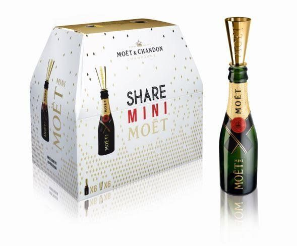 """<i>Mo&euml;t &amp; Chandon imperial share pack, <a href=""""http://www.premierchampagne.com/products/moet-chandon-imperial-share-pack-6-x-187ml-mini-bottles-with-sippers.html"""" target=""""_blank"""">$99.95 at Premierchampagne.com</a></i>"""