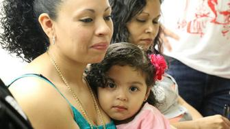 Liliana Cruz Mendez an undocumented woman from El Salvador with her daughter