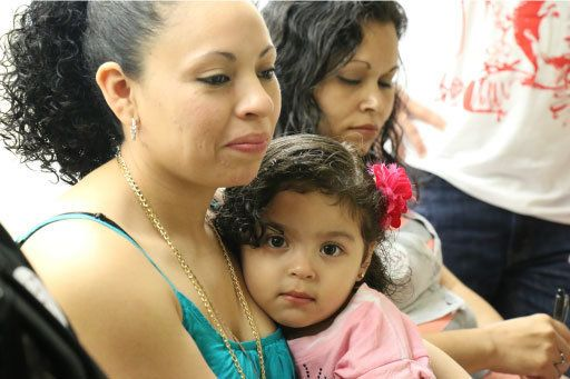 Liliana Cruz Mendez, an undocumented woman from El Salvador, with her daughter.
