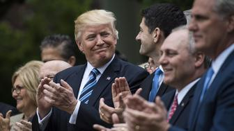 WASHINGTON, DC - MAY 4: President Donald Trump looks to House Speaker Paul Ryan of Wis., and other House congressmen in the Rose Garden after the House pushed through a health care bill, at the White House in Washington, DC on Thursday, May 04, 2017. (Photo by Jabin Botsford/The Washington Post via Getty Images)