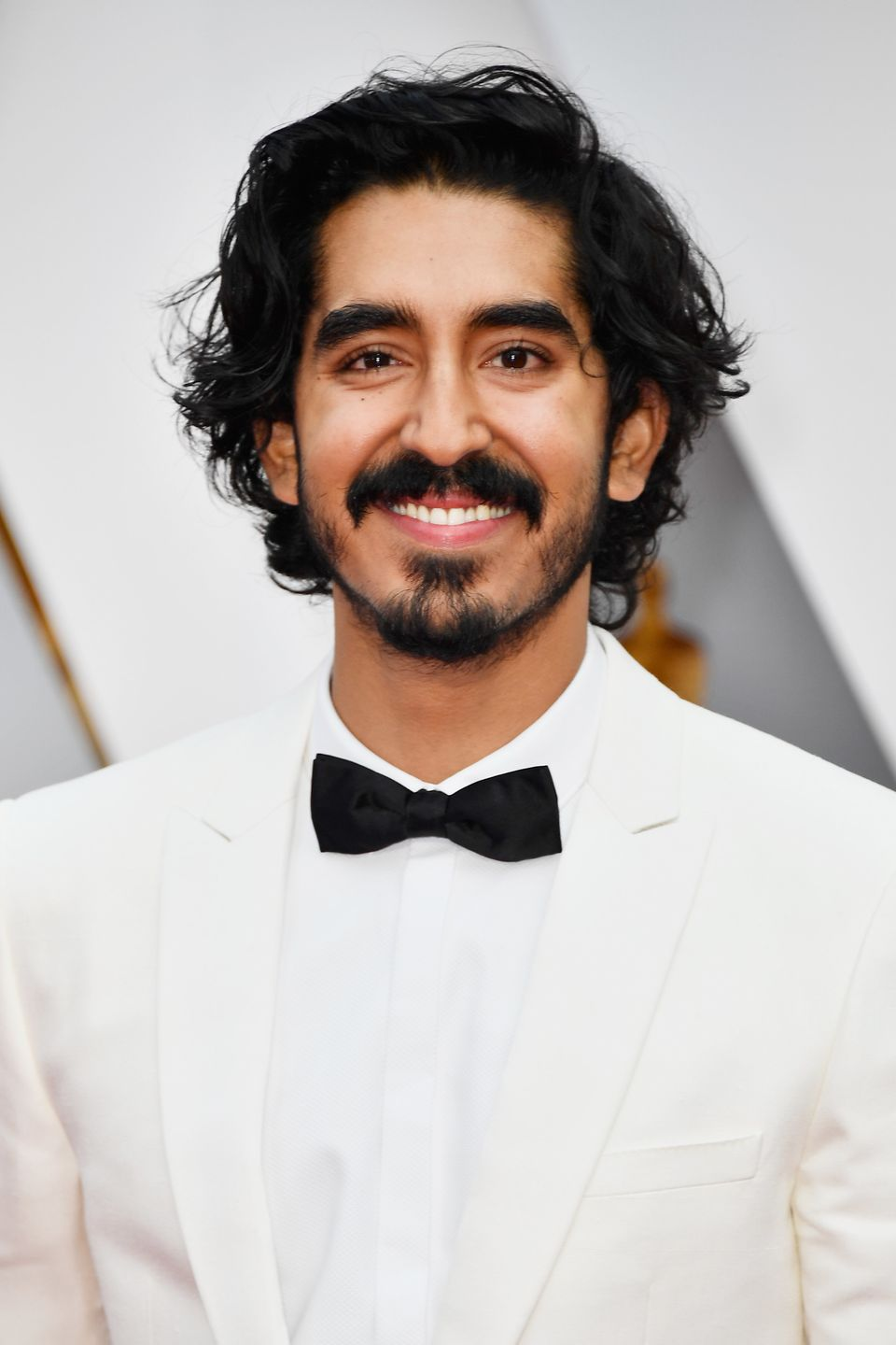 "<a href=""http://www.huffingtonpost.com/entry/dev-patel-is-a-curly-haired-god_us_58b06244e4b0a8a9b781a634"">Dev Patel</a> is th"