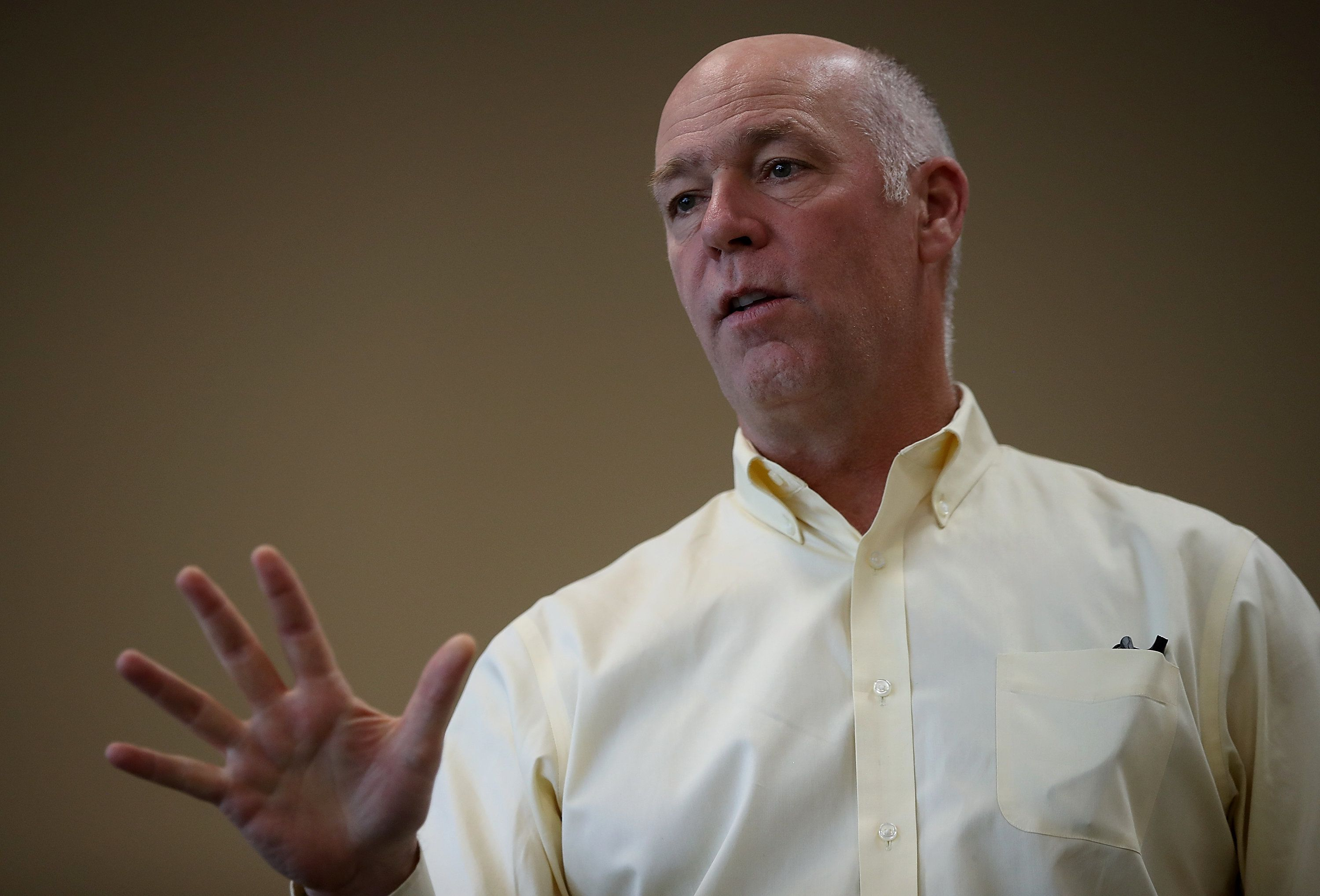 MISSOULA, MT - MAY 24:  Republican congressional candidate Greg Gianforte speaks to supporters during a campaign meet and greet at Lambros Real Estate on May 24, 2017 in Missoula, Montana.  Greg Gianforte is campaigning throughout Montana ahead of a May 25 special election to fill Montana's single congressional seat. Gianforte is in a tight race against democrat Rob Quist.  (Photo by Justin Sullivan/Getty Images)