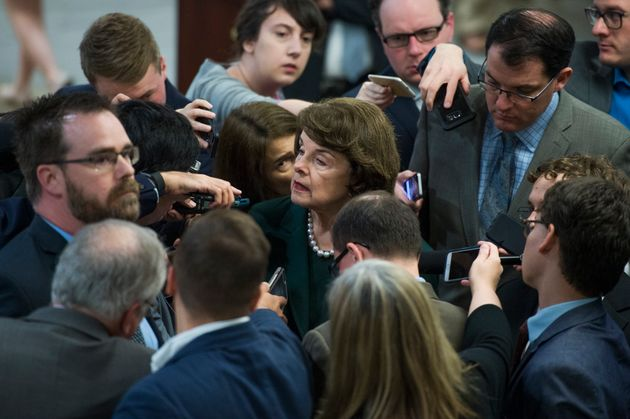 Sen. Dianne Feinstein (D-Calif.) talks to reporters but doesn't punch
