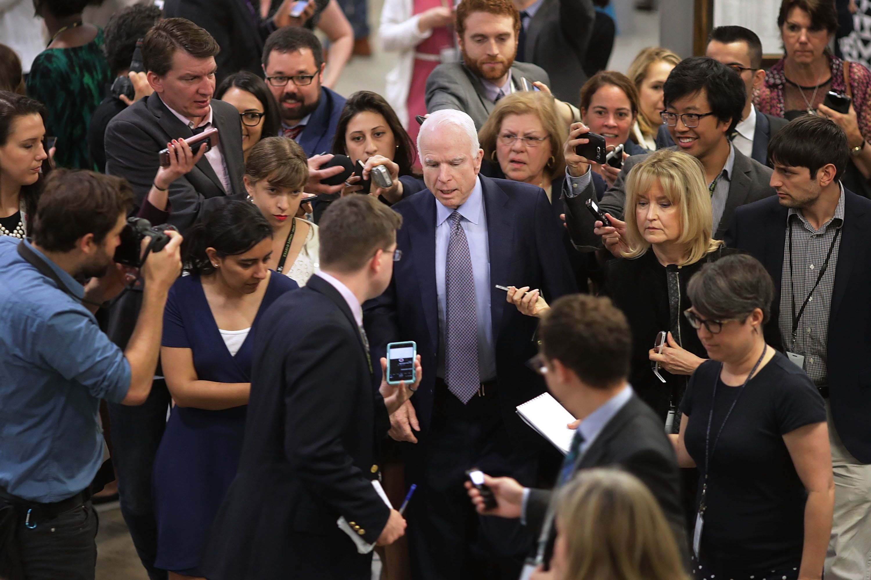 Sen. John McCain (R-Ariz.) talks to reporters instead of throwing them to the ground.