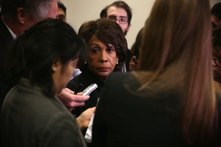 Rep. Maxine Waters (D-Calif.) manages to keep it together even though Guardian journalist Ben Jacobs is standing behind her.&
