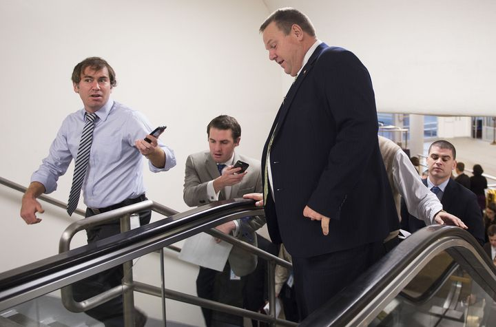 Sen. Jon Tester (D-Mont.) is able to walk up an escalator and deal with reporter questions.