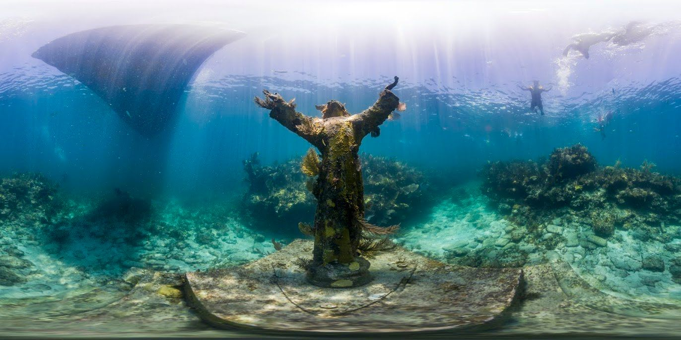 """The""""Christ of the Abyss"""" statue is located in the Key Largo Dry Docks Sanctuary Preservation Area of Florida Keys National Marine Sanctuary. In addition to attracting numerous invertebrates that have attached to its surface, giving it a colorful living texture, this nine-foot bronze statue is a popular destination for snorkelers and divers."""
