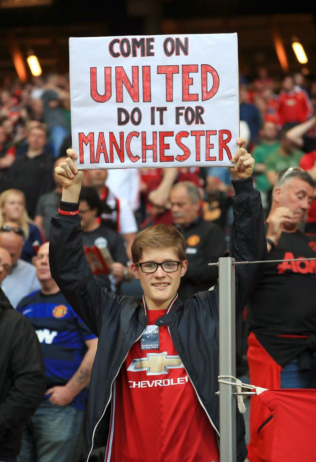 A fan holds a banner during Wednesday night's