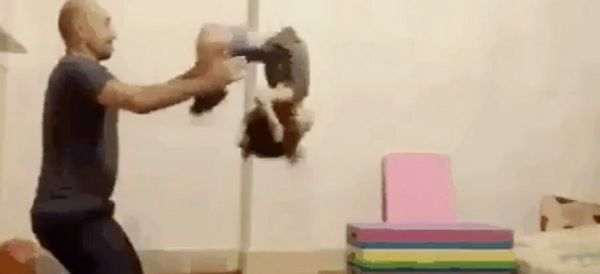Daddy-Daughter Gymnastic Trick Is Seriously Impressive (But Don't Try It At Home)