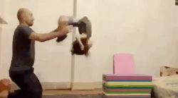 Daddy-Daughter Gymnastic Trick Is Seriously Impressive (But Don't Try It At