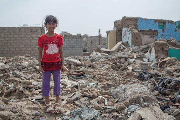 Zahra stands in the rubble at her destroyed home, in the south-western city of Lahj, Yemen, which...